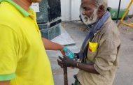 Touching moment: Volunteers doing their bit helping the old and the sick and the homless by providing them food,  on hot sultry day in Chennai...