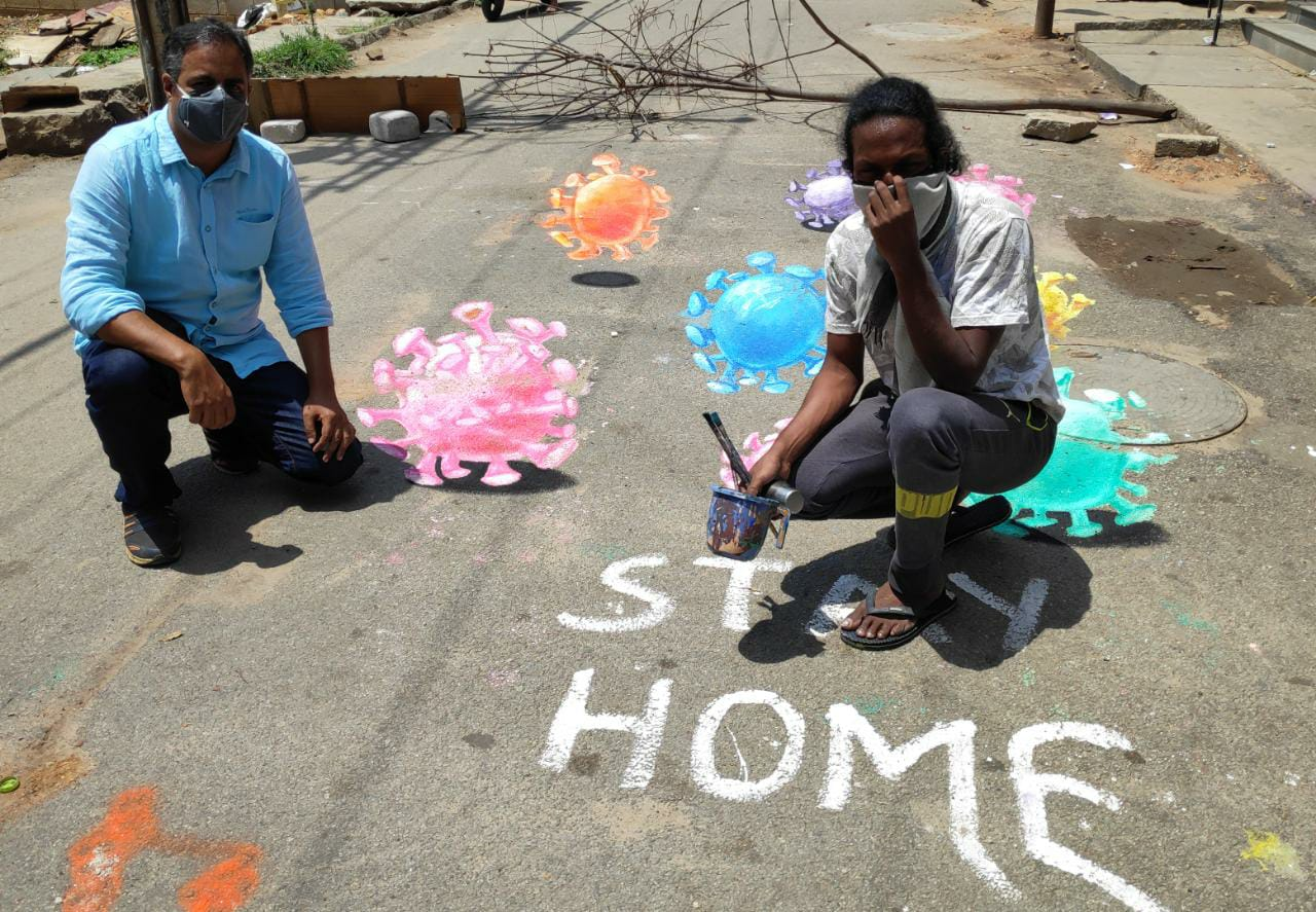 Artist Baadal Nanjundaswamy painted 3d Corona virus with a   message Stay home Stay Safe